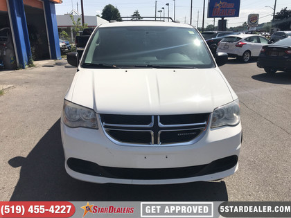 pre-owned Grand Caravan